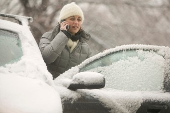 Woman on a Cell Phone in a Snow Storm